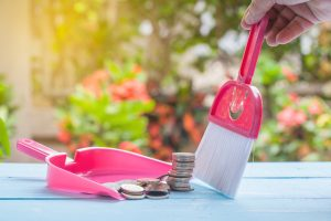 commercial cleaning services cost hand dusting coins money into dust pan