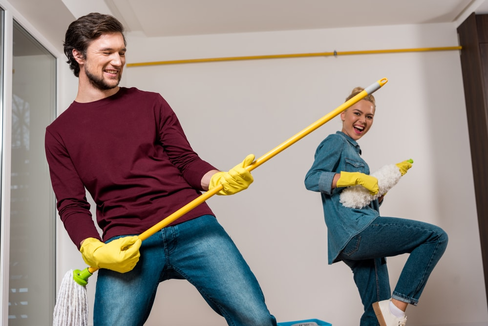man and woman laughing having fun while spring cleaning business