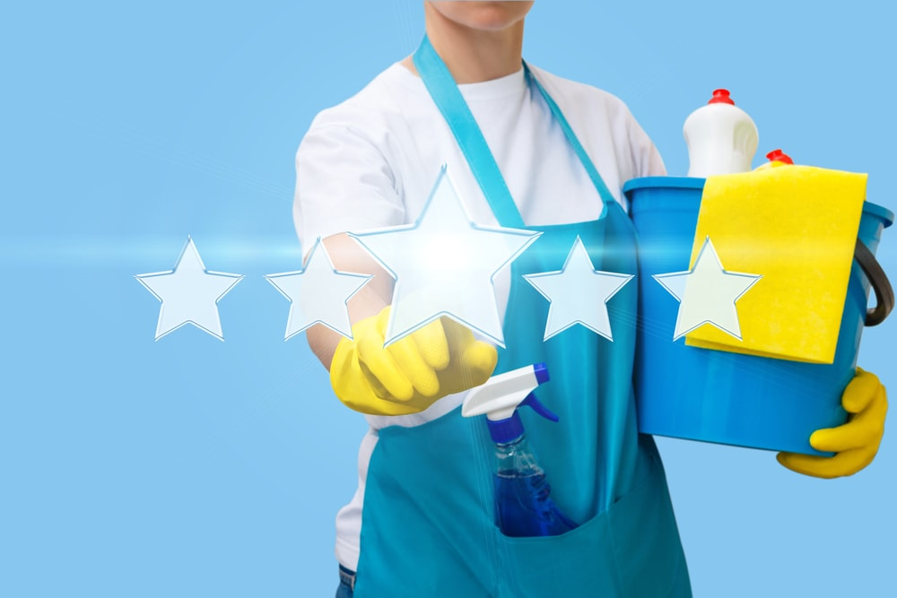 Worker clicks on the star. The concept of rating the cleaning. Professional school cleaning services evaluate school janitorial services. 5 star best school cleaning company.
