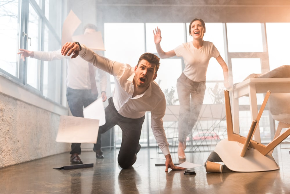 Photo of businessman man in office slipping and falling on floor dropping papers and coffee hiring a commercial cleaning business reduces safety risks