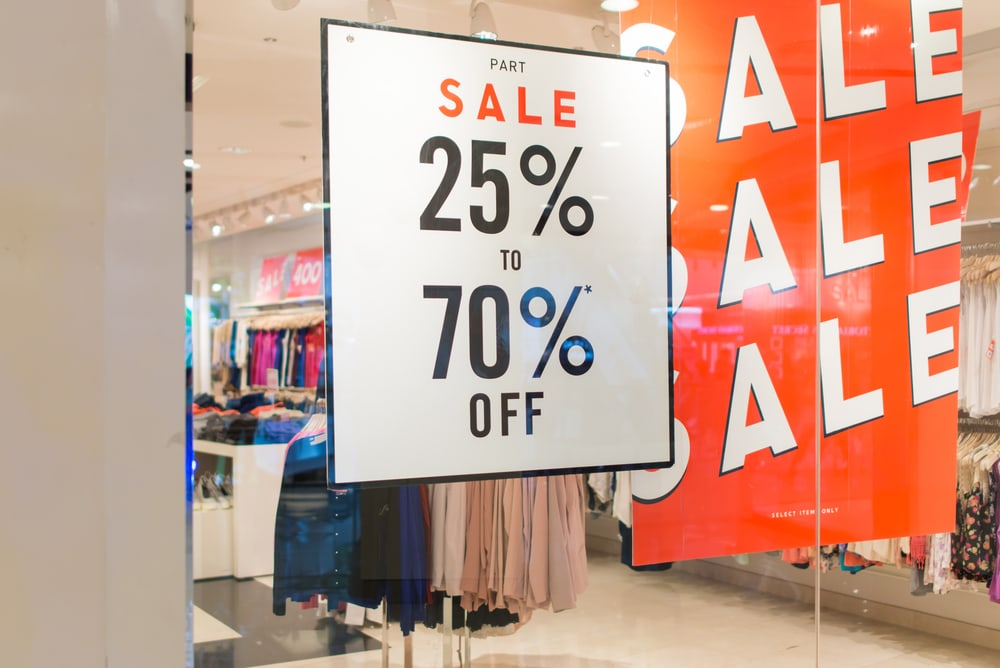 Fall and holiday shopping season front of shop with sale signs professional retail store cleaning services benefits
